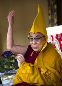 Tibetan spiritual leader the Dalai Lama wears a ceremonial yellow hat as he gives a religious talk on the 15th day of the Tibetan New Year in Dharmsala, India, Thursday, March 8, 2012(Ashwini Bhatia - AP)