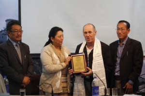Kalon Dolma Gyari presenting a souvenir to Mr KIllelea at the felicitation. Also present are Secretary Sonam Topgyal Khorlatsang, and Additional Secretary Chemi Rigzen of the Department of Home.