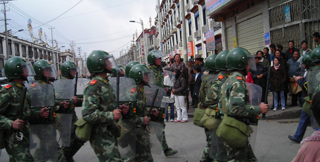 Chinese security forces patrol a street in Lhasa, the capital of Lhasa/File photo