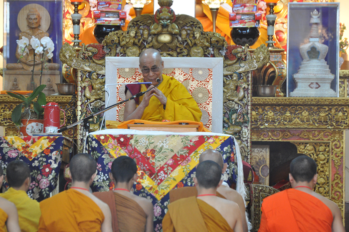 Monks from Southeast Asian countries pray on the first day of a three-day teaching by His Holiness the Dalai Lama the main temple in Dharamsala, India, on 3 September 2013