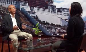 Dr Tseten Dorjee speaks to a TIbet TV reporter during interview at DIIR