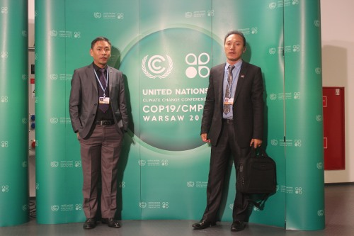 Jigme Norbu (left) with Zamlha Tempa Gyaltsen at the COP19 climate conference in Warsaw, Poland.