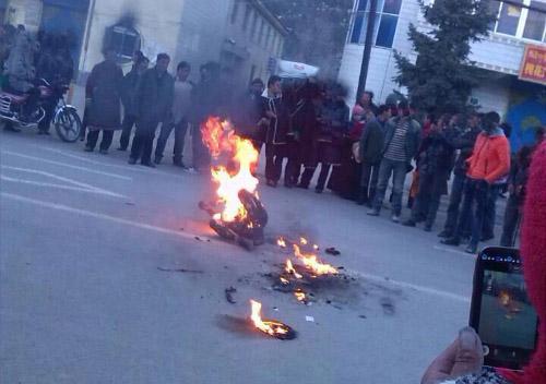 The burning image of Tsering Gyal on 11 November 2013.
