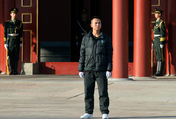 A plainclothes security guard outside the Zhongnanhai leadership compound in Beijing on Tuesday. China's new national security committee will deal with cybersecurity as well as the unrest in China's Tibet and Xinjiang regions, according to one expert/Photo/Associated Press