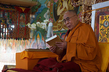 """His Holiness the Dalai Lama holding a copy of """"Opening the Eye of Discernment"""" introduced at the start of the fourth day of teachings at Sera Jey Monastery in Bylakuppe, Karnataka, India on December 28, 2013. Photo/Jeremy Russell/OHHDL"""