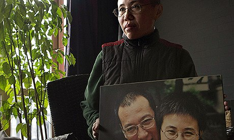 Liu Xia, pictured in 2012, has been under virtual house arrest since 2010. Her husband Liu Xiaobo was jailed in 2009. Photograph: Ng Han Guan/AP