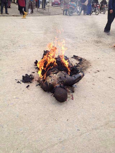 Tsultrim Gyatso after setting himself on fire in Achok town in Sangchu county in Kanlho in northeastern Tibet on 19 Dec. 2013