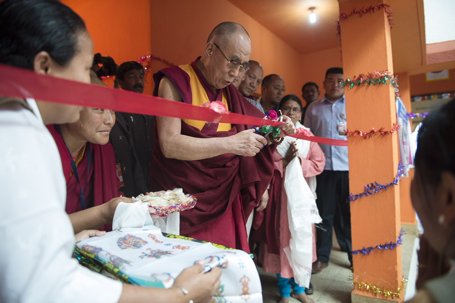 His Holiness the Dalai Lama cutting a ribbon to inaugurate an exhibit by students at the CTSA School in the Bandara Tibetan Settlement in Bandara, Maharshtra, India on January 11, 2014. Photo/Tenzin Choejor/OHHDL