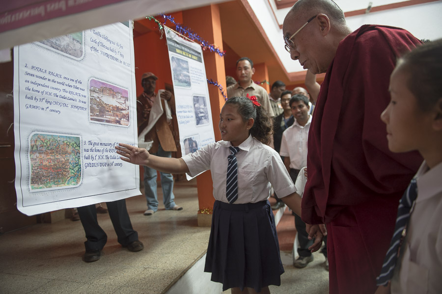 A student explaining to His Holiness the Dalai Lama one of the exhibits at the CTSA School in the Bandara Tibetan Settlement in Bandara, Maharshtra, India on January 11, 2014. Photo/Tenzin Choejor/OHHDL