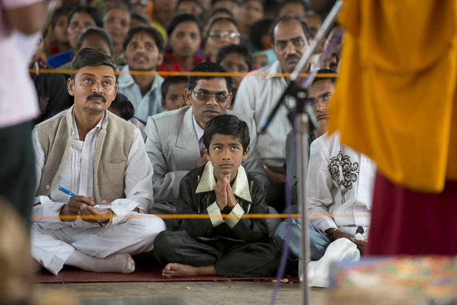 Members of the audience listening to His Holiness the Dalai Lama speaking during a meeting with local Indians in in Bandara, Maharshtra, India on January 12, 2014. Photo/Tenzin Choejor/OHHDL