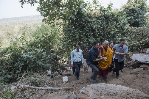 His Holiness the Dalai Lama climbing the hill to the Chaanda Devi Caves where the Indian philosopher Nagarjuna meditated in Sirpur, Chattisgarh on January 14, 2014. Photo/Tenzin Choejor/OHHDL