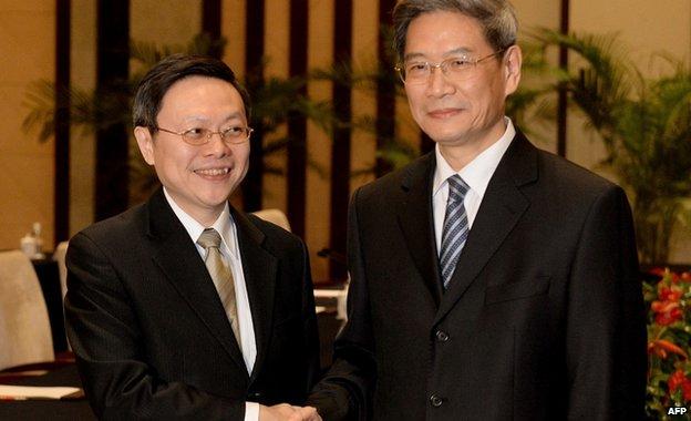 Top Taiwan official Wang Yu-chi (left) met his mainland China counterpart Zhang Zhijun on Tuesday/AFP