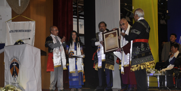 His Holiness the Dalai Lama being conferred an honorary doctorate at the 6th convocation ceremony of Martin Luther Christian University in Shillong on 3 February 2014