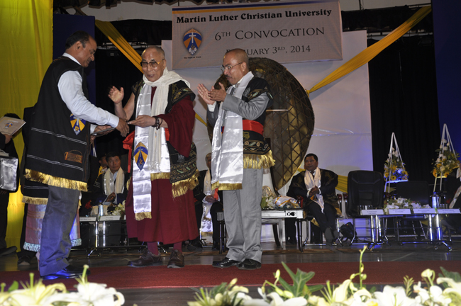 His Holiness the Dalai Lama presents degree to a graduate at the 6th convocation ceremony of Martin Luther Christian University in Shillong on 3 February 2014