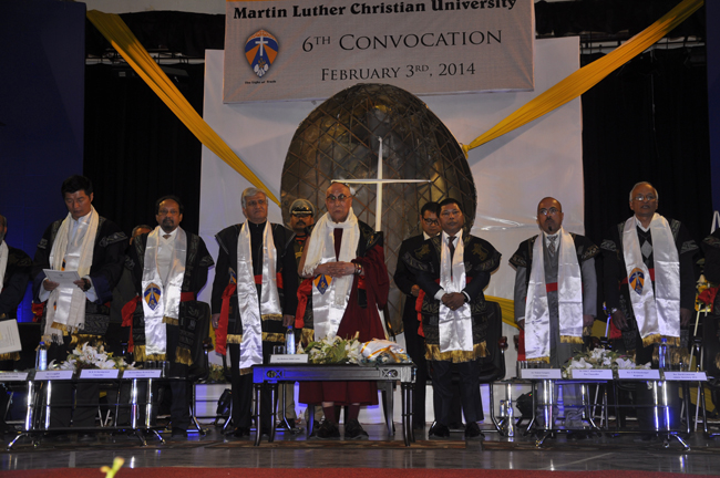 From L-R): Sikyong Dr Lobsang Sangay, Chancellor Dr K M Shyamaprasad, Governor Dr K K Paul, His Holiness the Dalai Lama, Chief Minister Dr Mukul Sangma and Vice-Chancellor  R G Lyngdoh stand up Indian national anthem at the convocation ceremony of Martin Luther Christian University in Shillong on 3 February 2014