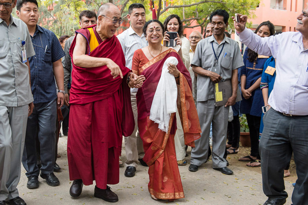 College Principal Dr. Meenakshi Gopinath with His Holiness the Dalai Lama on his arrival Lady Shri Ram College in New Delhi, India on March 20, 2014. Photo/Tenzin Choejor/OHHDL