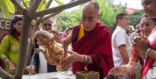 His Holiness the Dalai Lama watering a sapling planted to honor his visit to Lady Shri Ram College in New Delhi, India on March 20, 2014. Photo/Tenzin Choejor/OHHDL