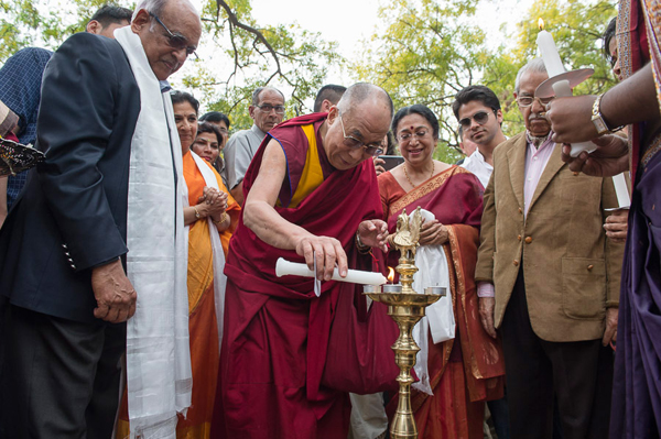 His Holiness the Dalai Lama lighting a lamp to inaugurate a new academic wing at Lady Shri Ram College in New Delhi, India on March 20, 2014. Photo/Tenzin Choejor/OHHDL