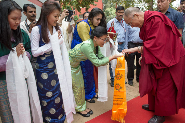 Tibetan students offering His Holiness the Dalai Lama a traditional greeting on his arrival at the venue for his talk at Lady Shri Ram College in New Delhi, India on March 20, 2014. Photo/Tenzin Choejor/OHHDL