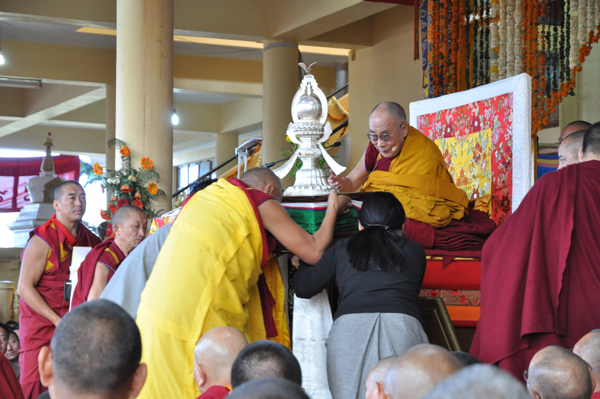 His Holiness the Dalai Lama receives an offering during the long life prayer ceremony at the main temple in Dharamshala, India, on 16 March 2014/DIIR Photo/Tenzin Phende
