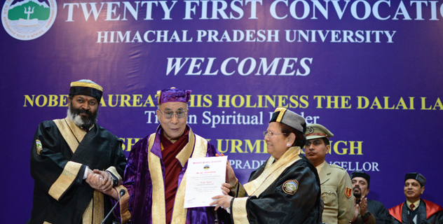 Himachal Pradesh Governor Urmila Singh (R) presenting His Holiness the Dalai Lama with an honorary degree from Himachal Pradesh University in Shimla, India on March 19, 2014. Also seen in the picture is Vice-Chancellor Dr. A D N Bajpayee (L)/Photo/DIIR photo/Tenzin Phende