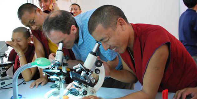 Arri Eisen, a biology professor at Emory, with student monks in Dharamsala, India, where Emory faculty has offered six-week science courses during the summers/Global Atlanta