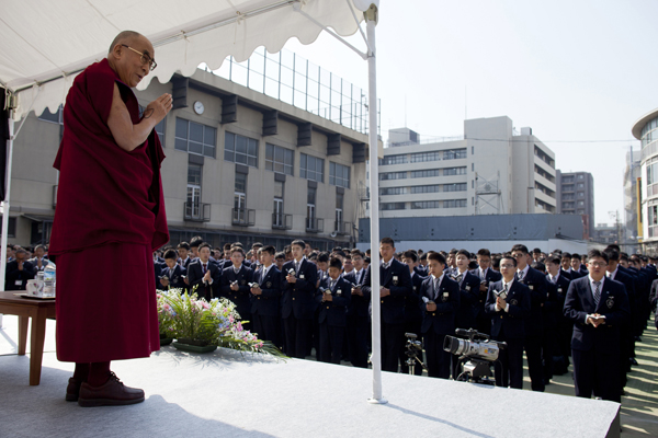 His Holiness the Dalai Lama greets Japanese students during his talk at Seifu Gakuen Boys High School in Osaka, Japan, on 9 April 2014/Photo/Office of Tibet