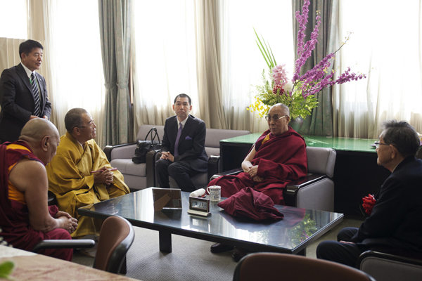 His Holiness the Dalai Lama during a meeting with officials after giving a talk on Tibetan Buddhism at Shuchin University in Kyoto, Japan, on 10 April 2014
