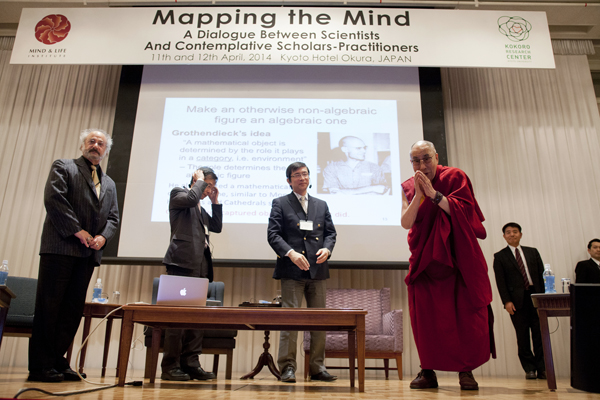 His Holiness the Dalai Lama greets participants at the conference on Mapping the Mind in Kyoto, Japan, on 11 April 2014/Photo/Office of Tibet