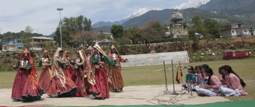 School students performing cultural dances at the event.