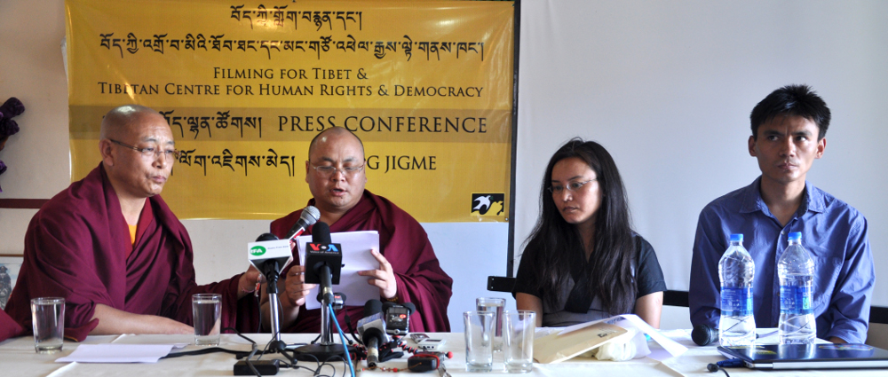 Golog Jigme (2nd from left) reading his statement at the press conference on 28 May 2014. (From left: Serthar Tsultrim, former Tibetan Parliamentarian, Golog Jigme, Ms. TSering Tsomo, Director, TCHRD and Tenzin Nyinjey,