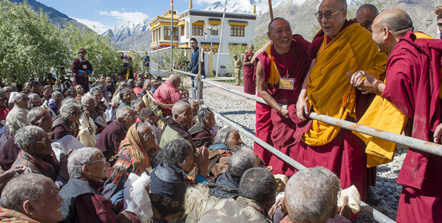 His Holiness the Dalai Lama greeting the crowd gathered to attend the first day of his three day teaching in Padum, Zanskar, J&K, India on June 23, 2014. Photo/Tenzin Choejor/OHHDL