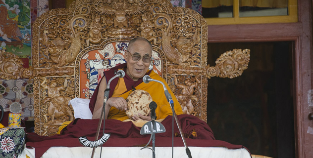His Holiness the Dalai Lama with some bread offered during his teaching in Padum, Zanskar, J&K, India on June 23, 2014. Photo/Tenzin Choejor/OHHDL