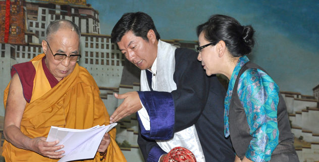 Tibetan political leader Dr Lobsang Sangay presents documents to His Holiness the Dalai Lama on Middle Way policy campaign at TCV school in Dharamsala, India, on 5 June 2014