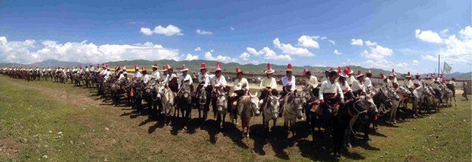 Tibetans participating in a horse race to celebrate the 79th birthday of His Holiness the Dalai Lama in Sangchu County, Kanlho.