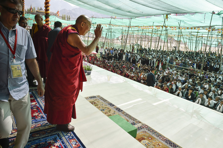 His Holiness the Dalai Lama greeting the over 9,000 volunteers who worked at the 33rd Kalachakra Empowerment in Leh, Ladakh, J&K, India on July 15, 2014. Photo/Manuel Bauer