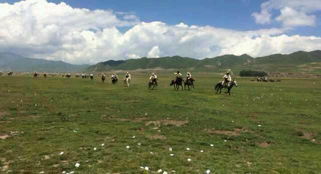 Tibetan horsemen in Kanlho on 6 July, celebrating the birthday of His Holiness the Dalai Lama.