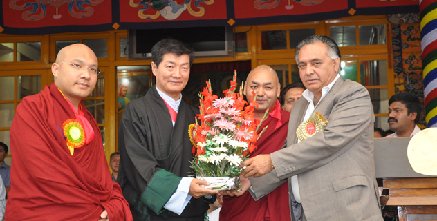 Mr G S Bali, Transport, Food, Civil Supplies & Consumer Affairs and Technical Education Minister in Himachal Pradesh government presents a bouquet from the Chief Minister to Sikyong Dr. Lobsang Sangay on the occasion of His Holiness the Dalai Lama on his 79th birthday celebrations in Dharamsala, India, 6 July 2014/DIIR Photo/Tenzin Phende