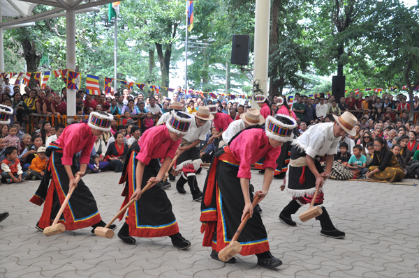 Tibetan schoolchildren presents a traditional dance on His Holiness the Dalai Lama's 79th birthday celebrations in Dharamsala, India, 6 July 2014