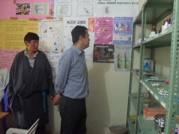 Health Kalon inspects a clinic  during his visit to a Tibetan settlement in Sirmour district in Himachal Pradesh