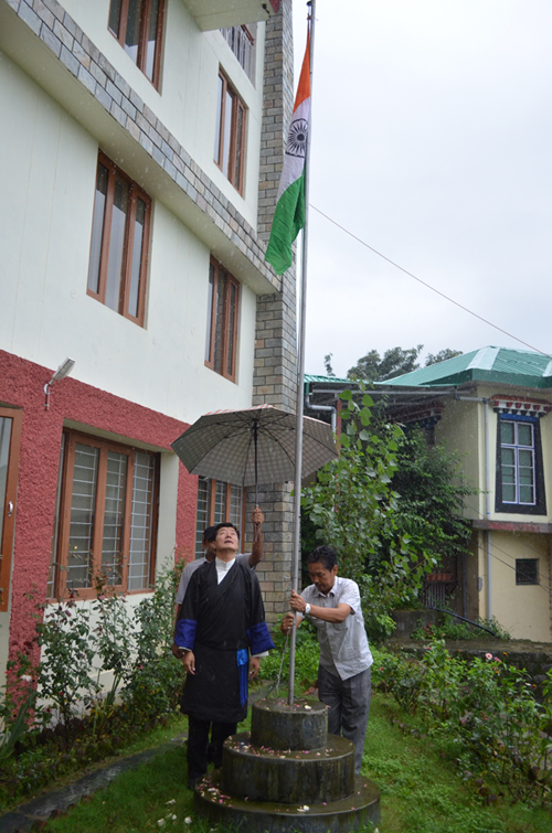 Sikyong looks up after hoisting the Indian national flag at a function to mark the 68th Indian independence day in Dharamshala on 15 August 2014