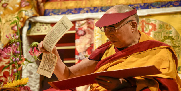 His Holiness the Dalai Lama holding the Tibetan text during the afternoon session of his teachings in Hamburg, Germany on August 25, 2014. Photo/Manuel Bauer