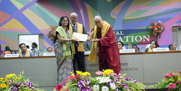 His Holiness the Dalai Lama handing out degrees to the first batch of Master of Law in Access to Justice graduating students at the Tata Institute of Social Sciences in Mumbai, India on September 17, 2014. Photo/Tenzin Choejor/OHHDL