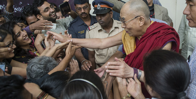 His Holiness the Dalai Lama reaching out to shake hands with well-wishers as he departs from the Tata Institute of Social Sciences in Mumbai, India on September 17, 2014. Photo/Tenzin Choejor/OHHDL