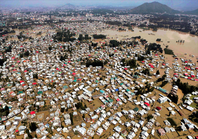 An aerial view showing buildings partially submerged in Srinagar/Photo: PTI