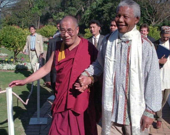 His Holiness the Dalai Lama with the late Nelson Mandela at Cape Town in August 1996.