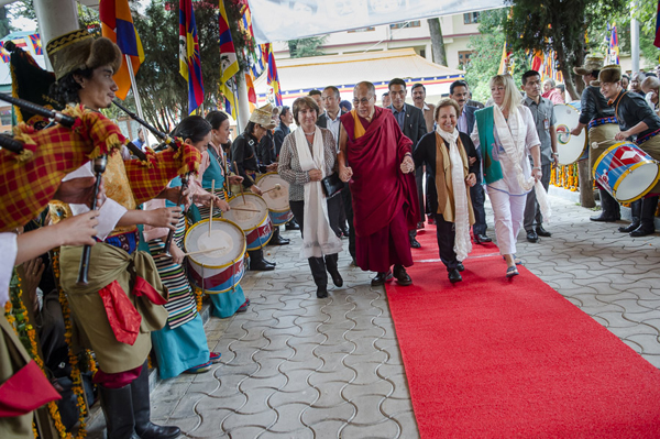 he band from the Tibetan Institute of Performing Arts plays as His Holiness the Dalai Lama and fellow Nobel Laureates Jody Williams and Shirin Ebadi walk towards the Main Tibetan Temple in Dharamsala, India on October 2, 2014. Photo/Tenzin Choejor/OHHDL