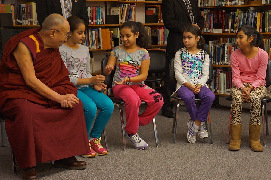His Holiness the Dalai Lama in the junior school students' classroom talking about gratitude at John Oliver School in Vancouver, Canada on October 21, 2014. Photo/Jeremy Russell/OHHDL
