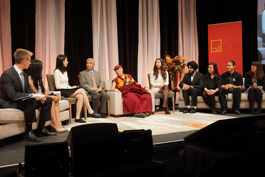 His Holiness the Dalai Lama along with a panel of students discussing the topic 'Educating the Heart' at John Oliver School in Vancouver, Canada on October 21, 2014. Photo/Jeremy Russell/OHHDL