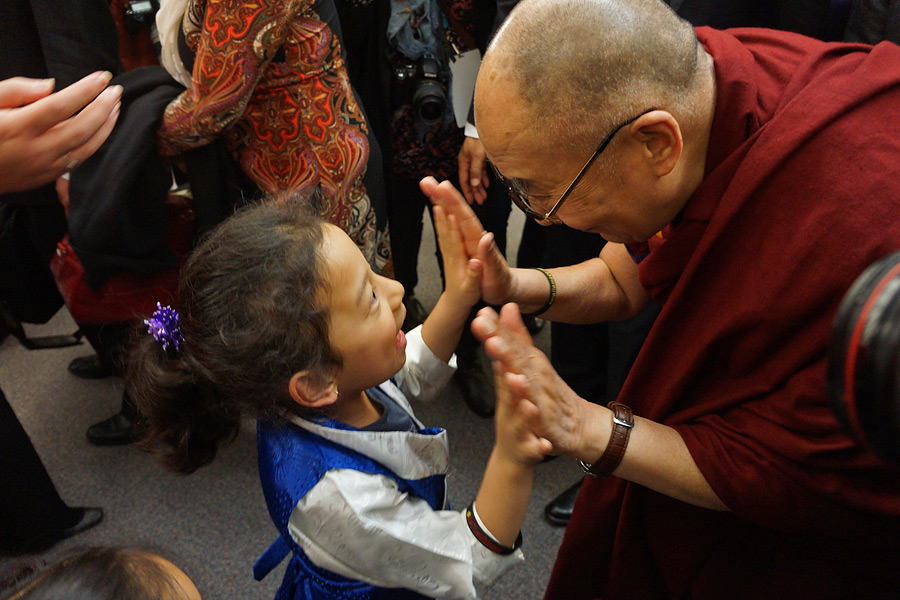 His Holiness the Dalai Lama greeting a young girl as he departs from John Oliver School in Vancouver, Canada on October 21, 2014. Photo/Jeremy Russell/OHHDL